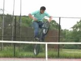 Asian Biker Vs Tennis Net