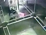 Asian Lady Stuck In Elevator Doors