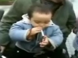2 Yr Old Asian Kid Smoking A Cigarette