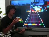 Geek Solves Two Rubik's Cubes While Playing Guitar Hero