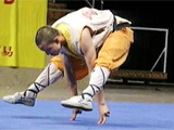 Shaolin Monk Balances On Two Fingers