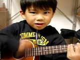 Asian Kid Playing Im Yours On Ukelele