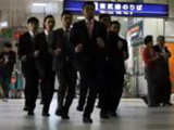 Synchronized Japanese Businessmen