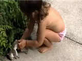 Little Girl Plays With Dead Squirrel