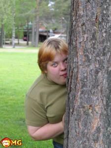 weird-guy-or-girl-behind-tree