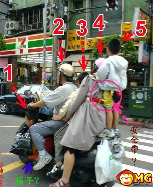 asian-family-on-scooter