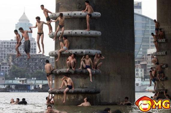 asian-guys-swimming-river