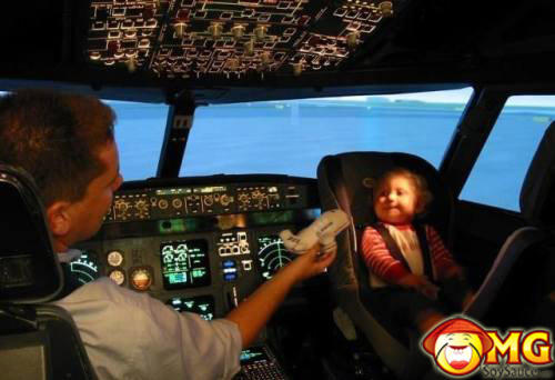 baby-riding-shotgun-in-airplane