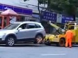 Crazy Asian Lady Drives Off With Tow Truck