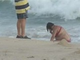 Large Woman Gets Washed Up On Beach